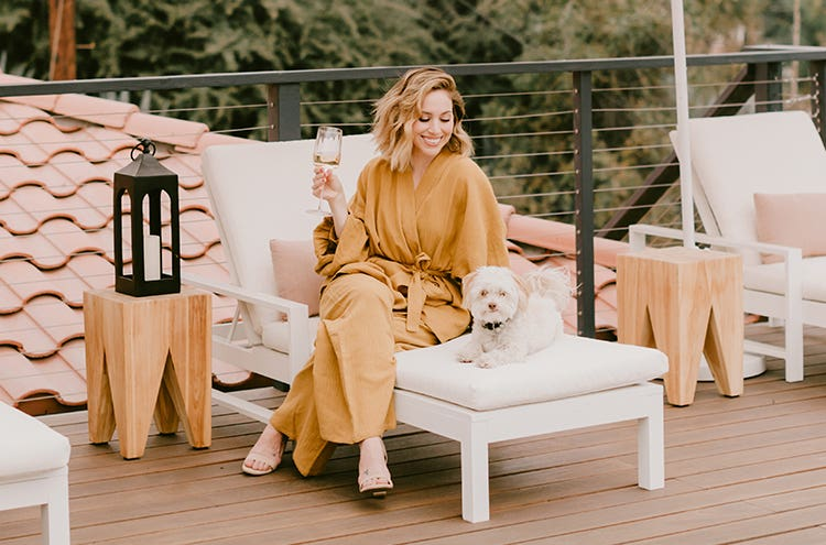 Jaclyn Johnson and her dog on the patio of her LA home