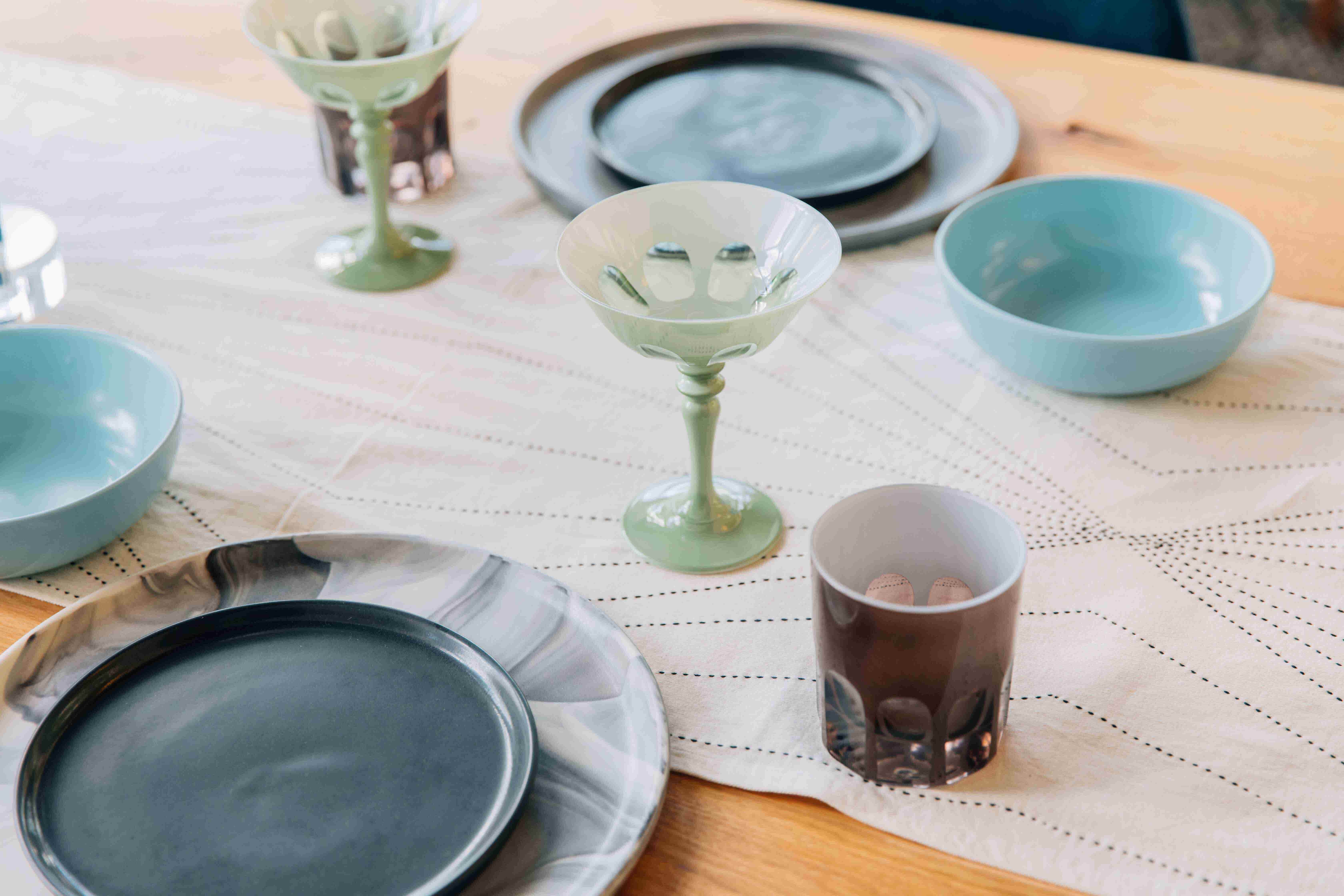 Colorful plates, glasses, and serveware by Favor
