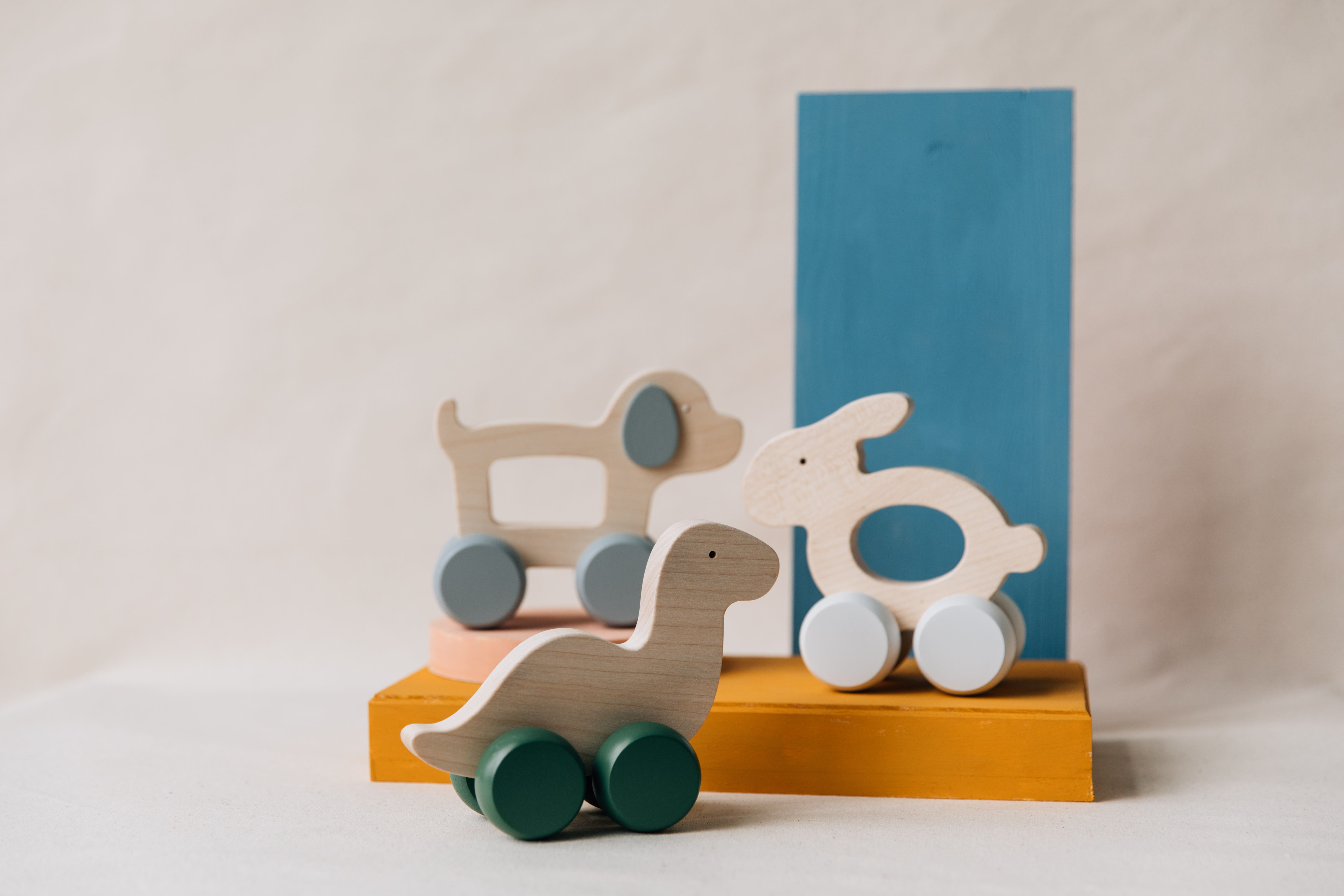 Three small wooden toys from Briki Vroom Vroom
