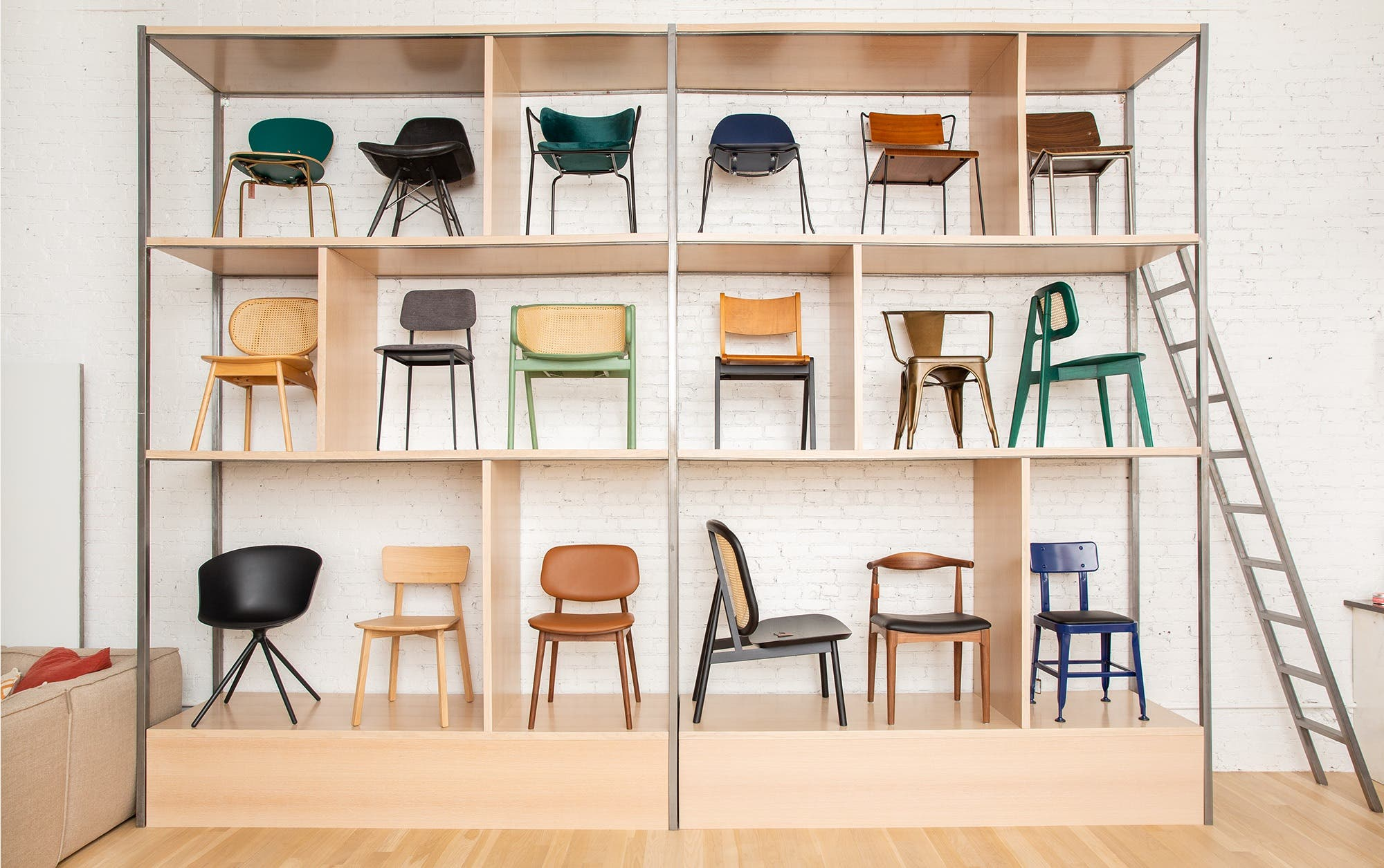 A selection of Industry West chairs arranged along tall shelves