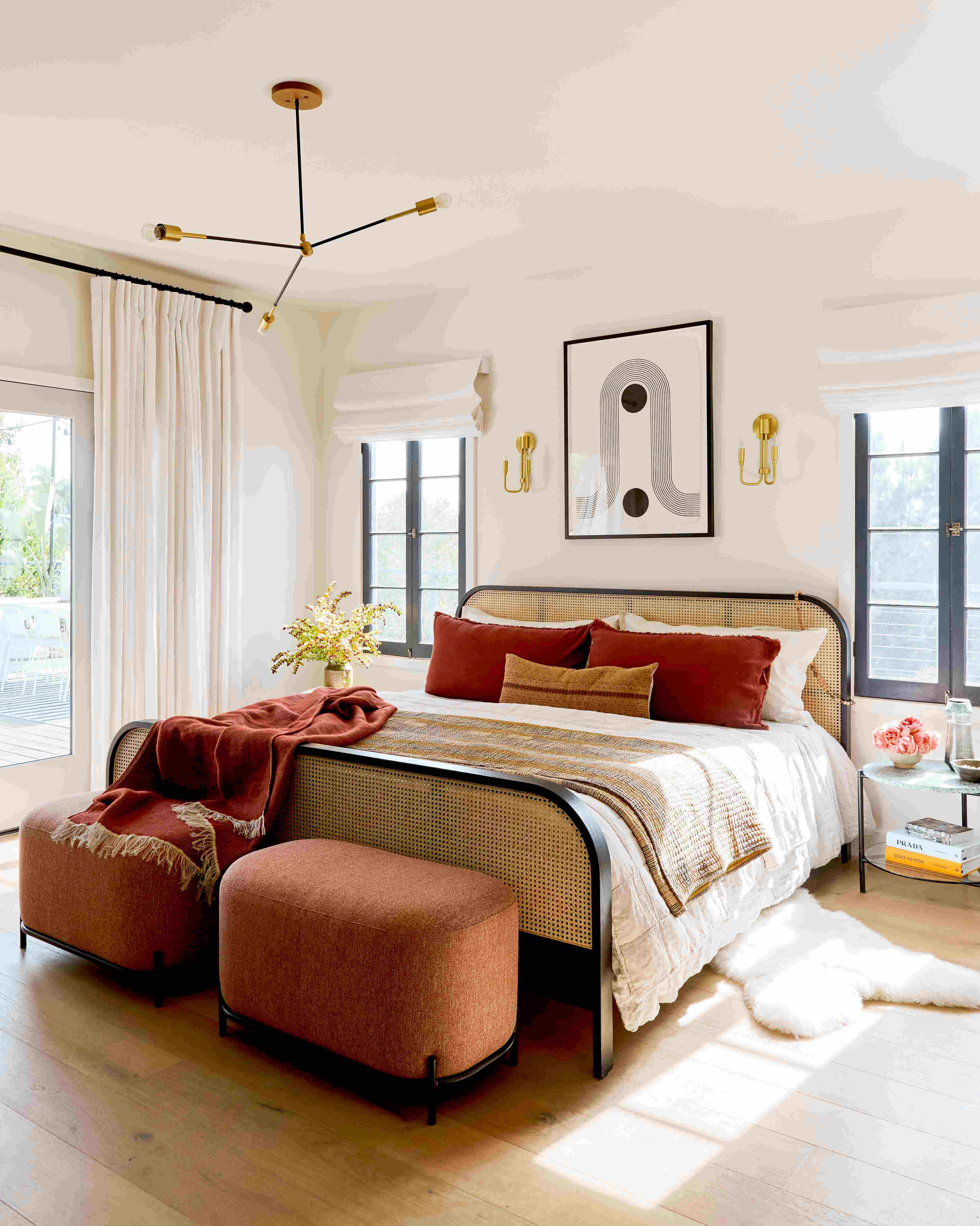 An Industry West Cane Bed and Hemlock Ottomans in Jaclyn Johnson's LA home
