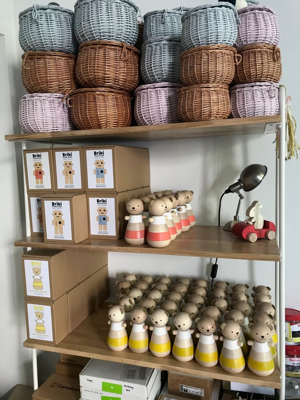 Shelf of wooden toys and baskets in the studio space for Briki Vroom Vroom