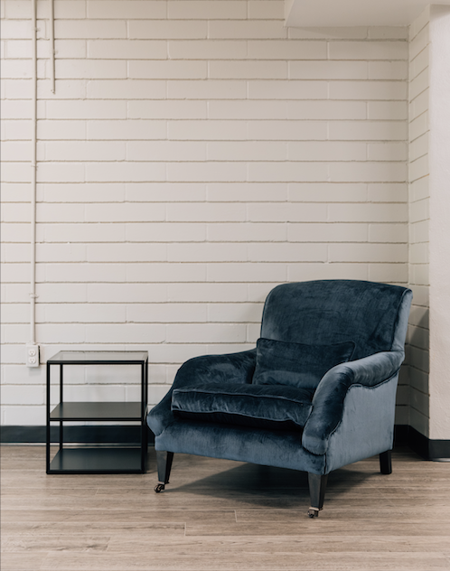 Blue lounge chair and side table at the Youth Crisis Center House of Hope