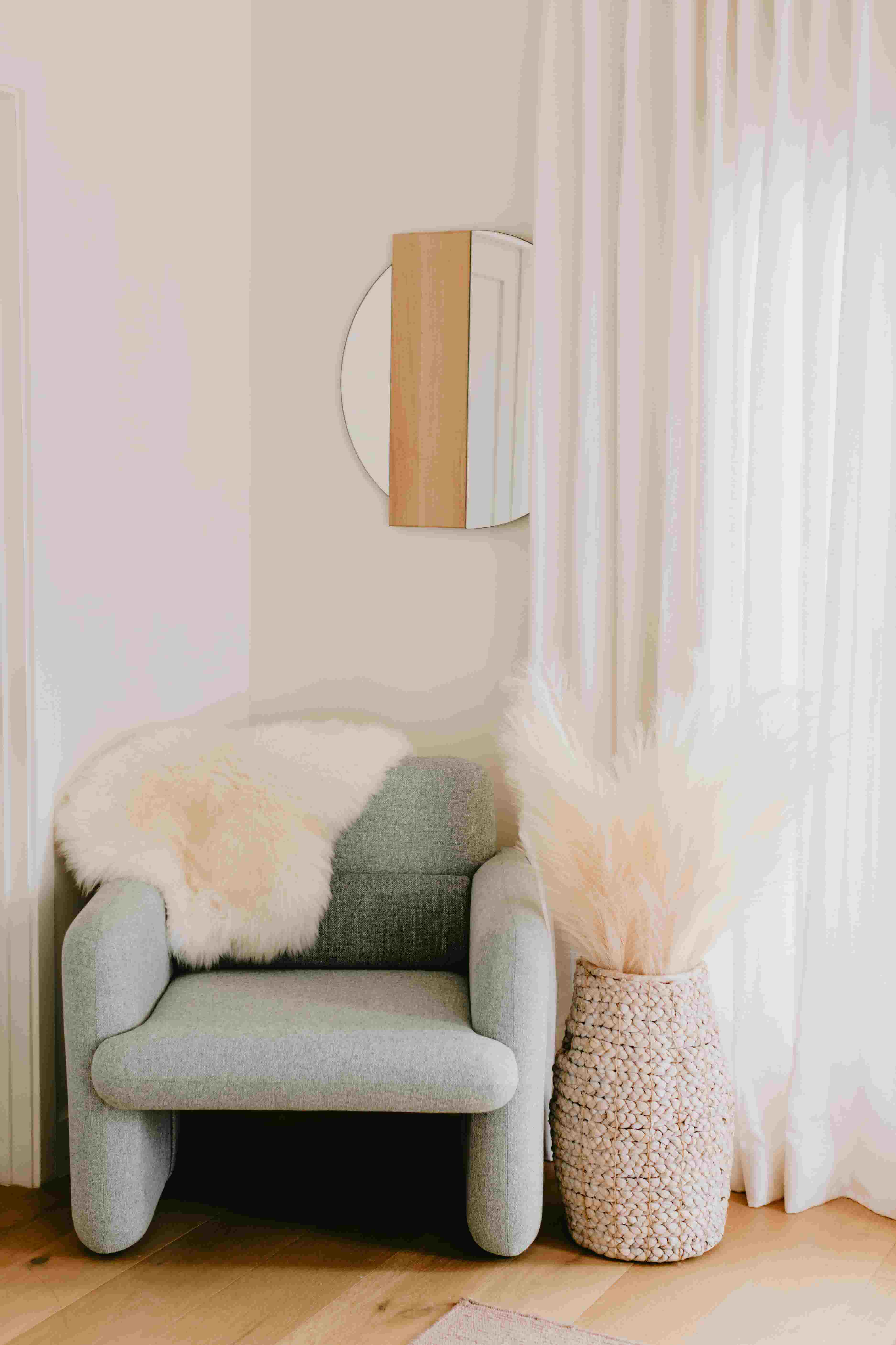 An Industry West Plume Chair and mirror in Jaclyn Johnson's LA home