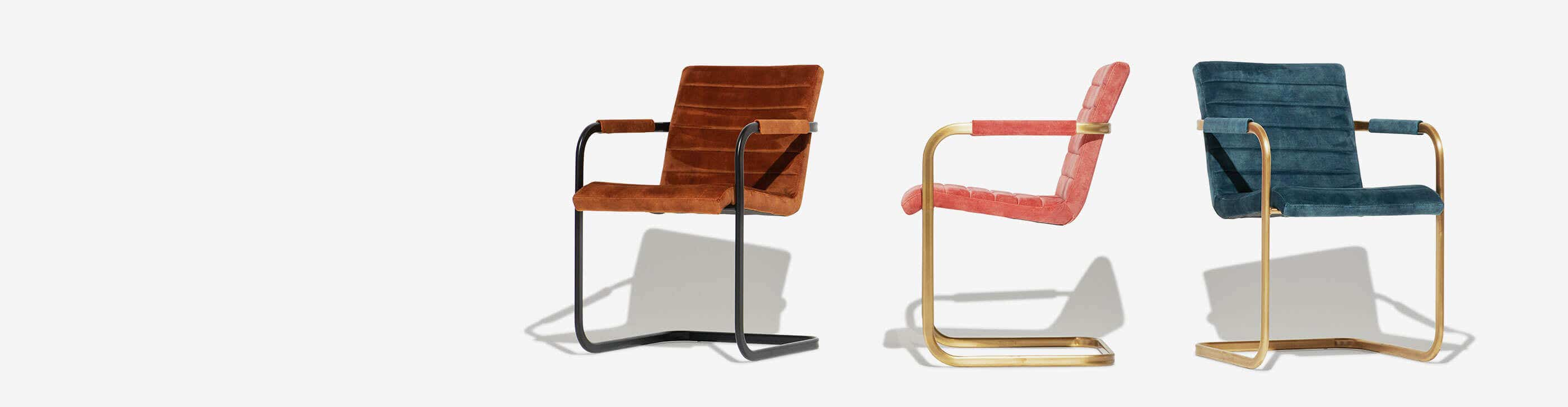 Three Industry West Sable arm chairs in different colors