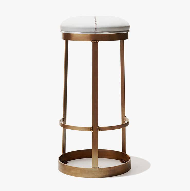 Industry West Zurich bar stool with a brass frame and white leather upholstery