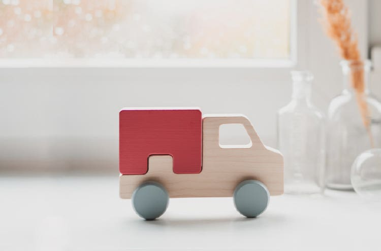 A small wooden toy truck
