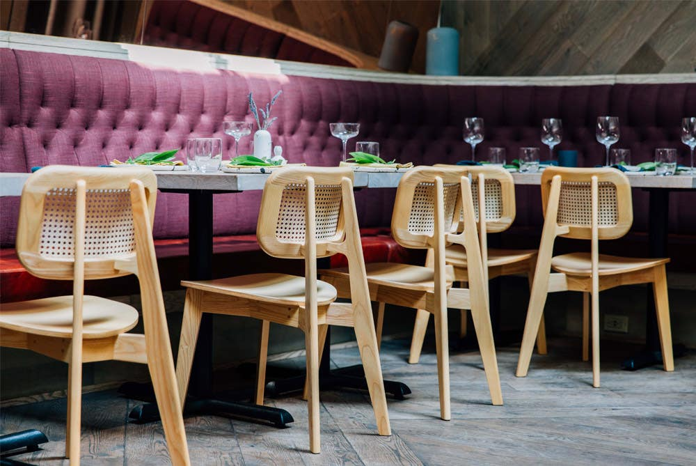 Industry West Cane Dining Chairs at a restaurant