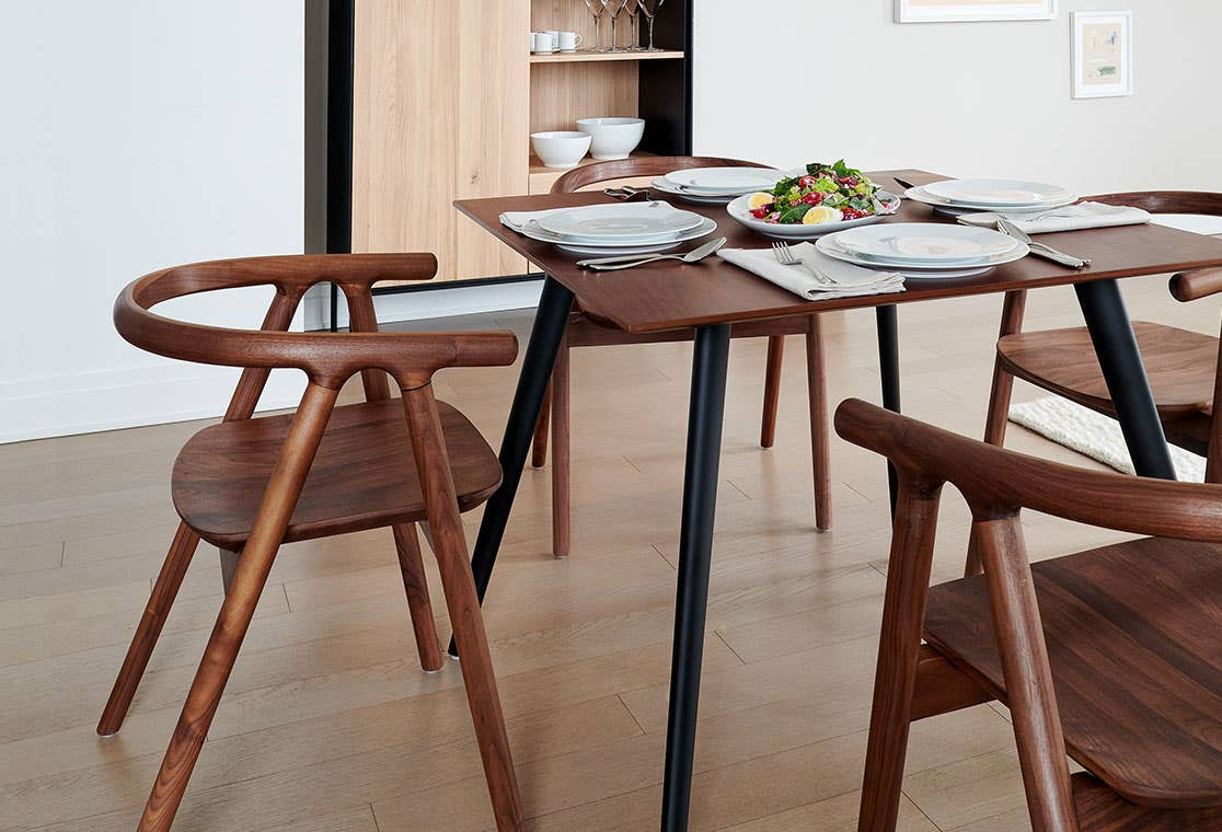 Industry West Tanaka wooden dining chairs around a dining table