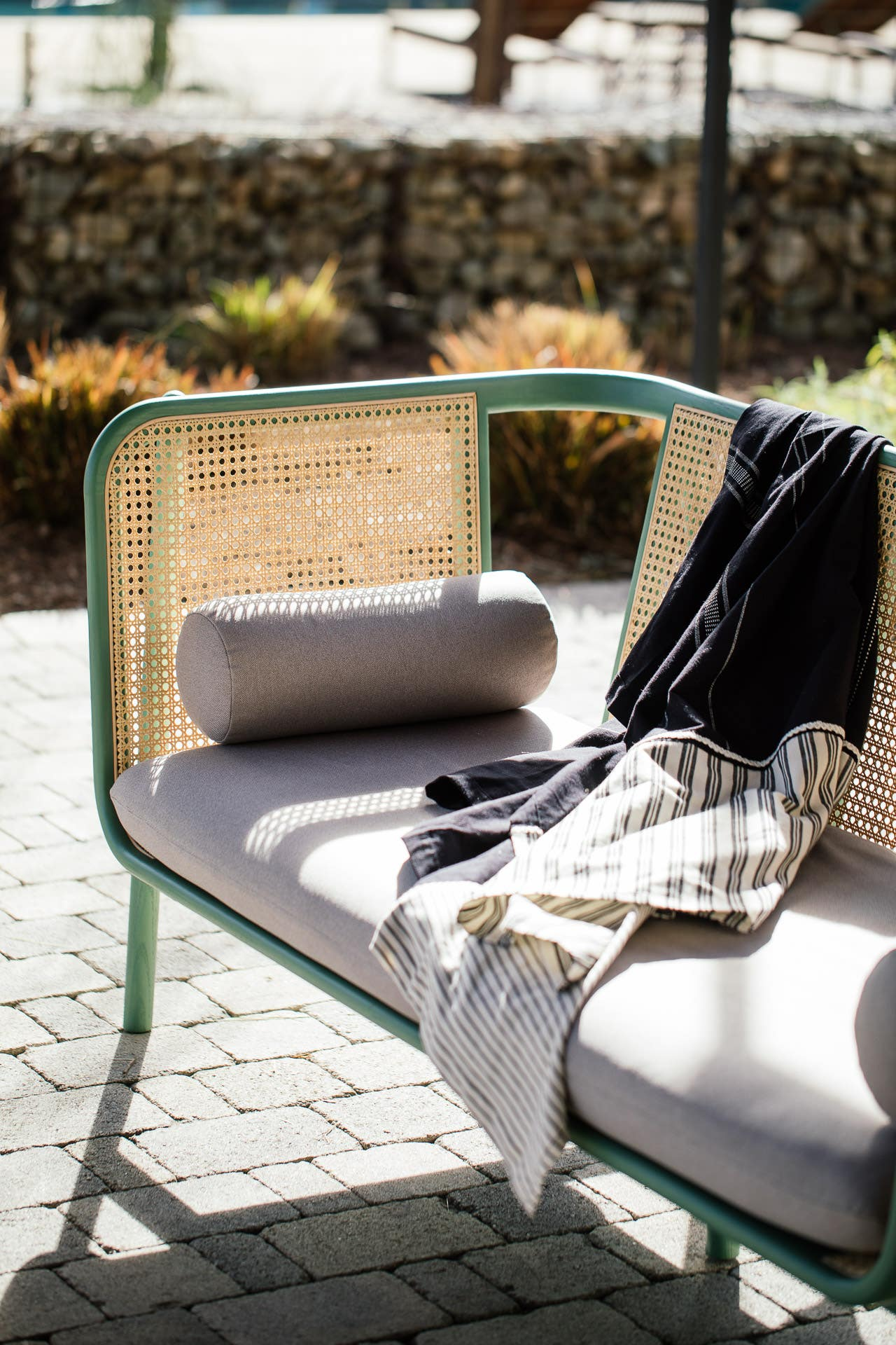 Industry West cane Hem Sofa with Favor throw on patio in Ojai, California