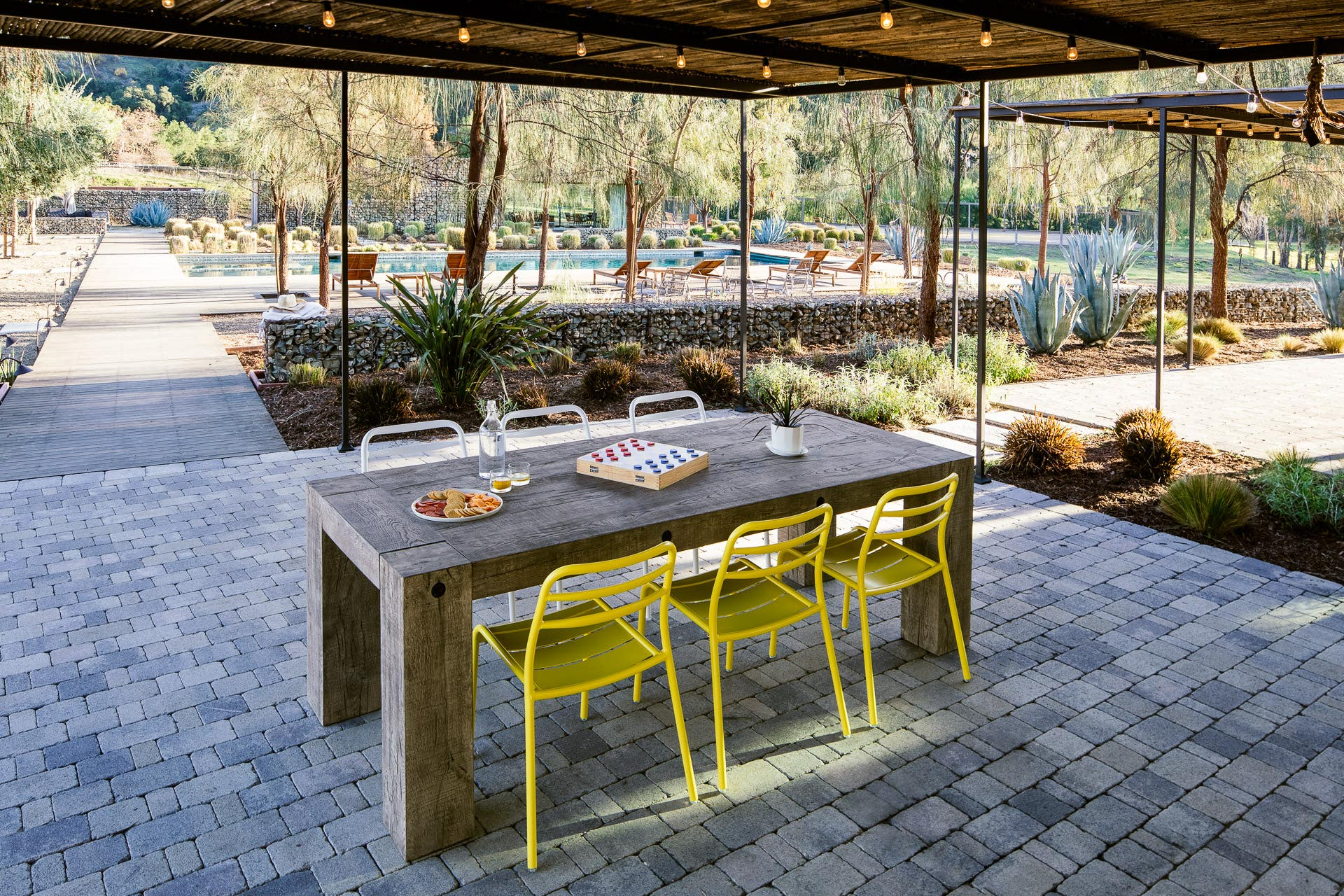 Industry West yellow aluminum outdoor patio dining chairs in Ojai, California