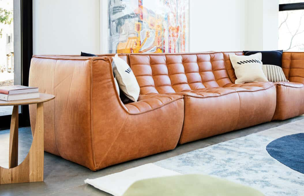 Photograph of Wren three-piece modular leather sofa in styled living room.