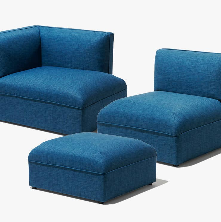 Three pieces of the modular Loom sofa in blue from Industry West