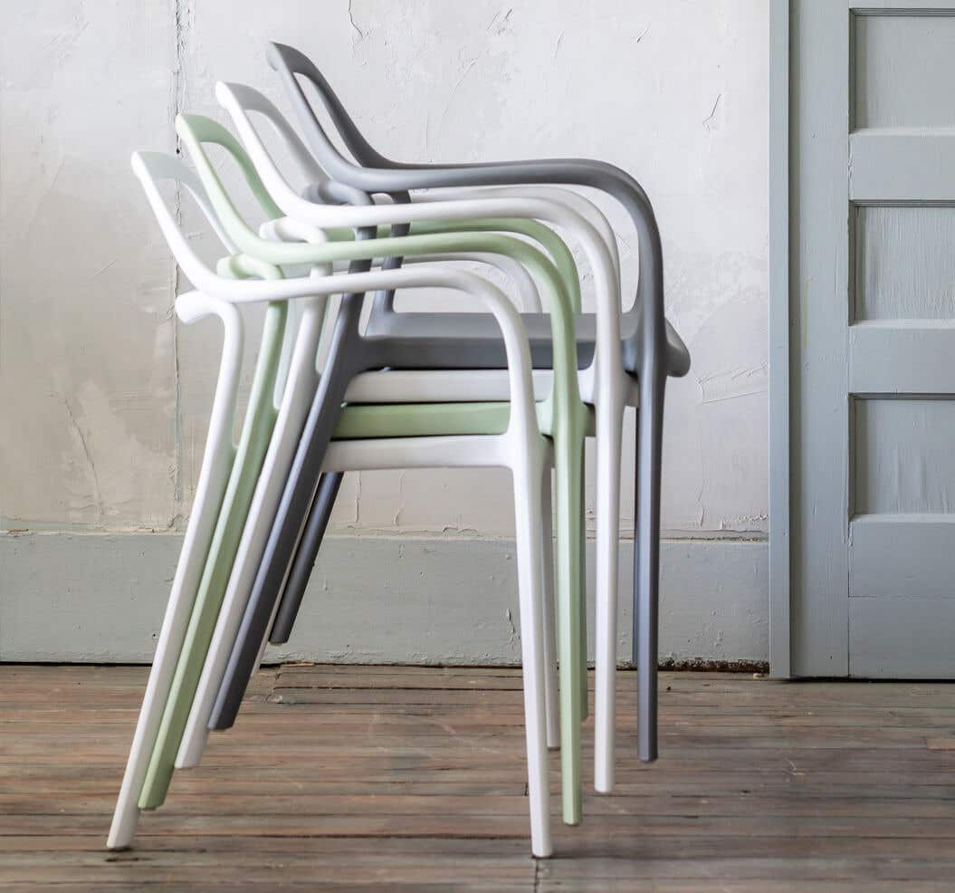 Group of stacked plastic chairs.
