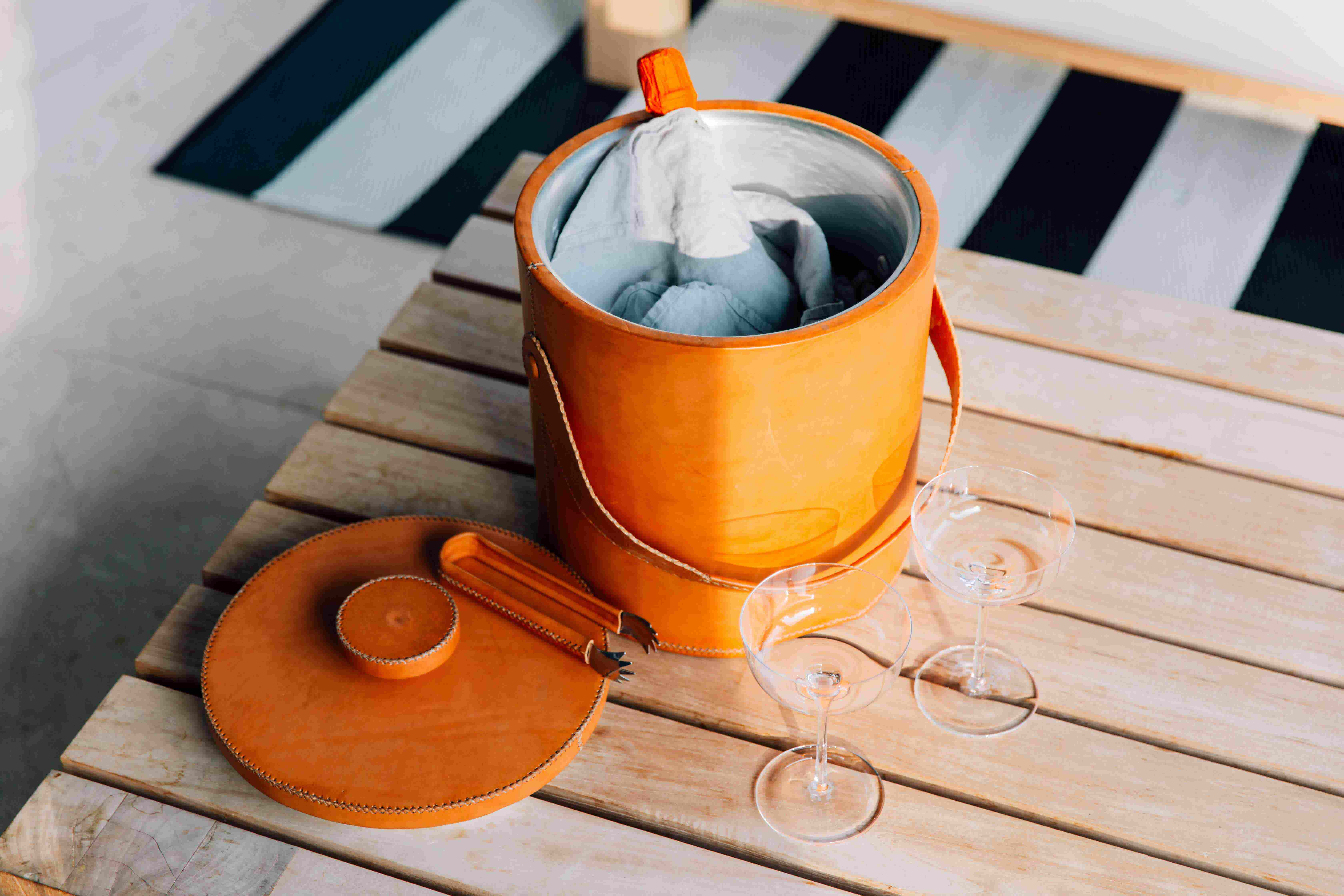 Leather ice bucket and wine glasses by Favor