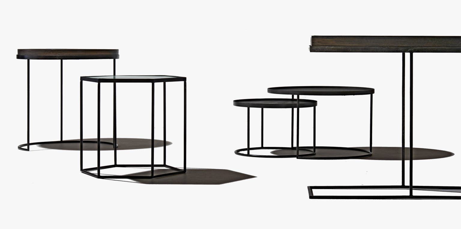 Five black metal tables from Industry West