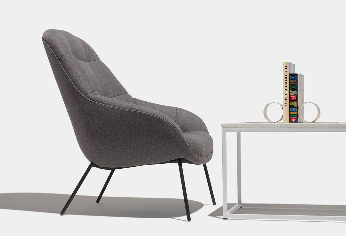 Industry West Sunday Lounge Chair in grey next to a white coffee table