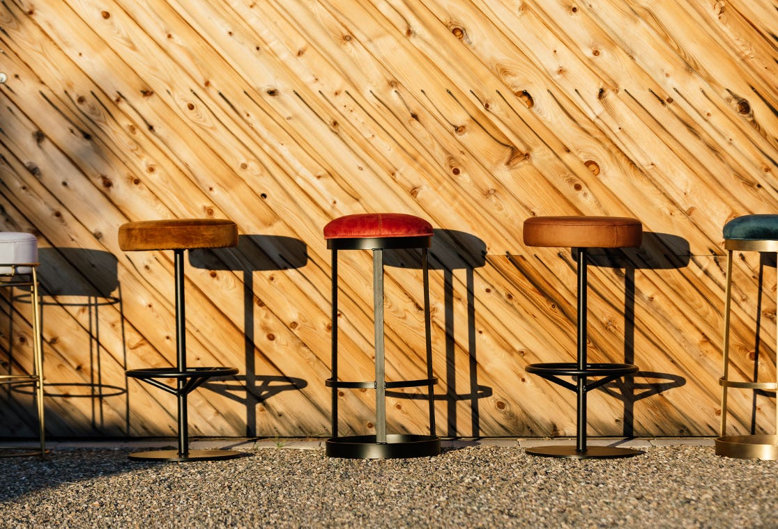 A variety of Industry West bar stools in different colors and materials